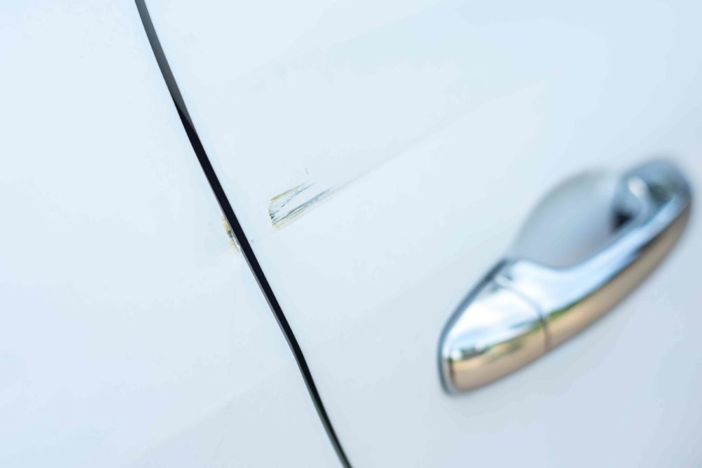 White Audi Paint Scratch on Door